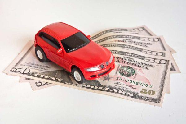 Car sitting on pile of cash
